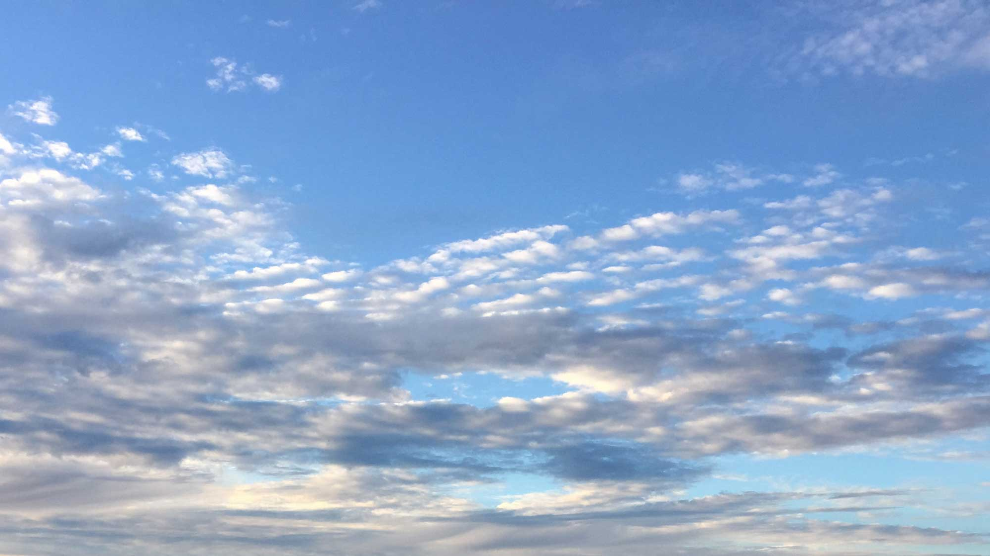 Photograph of clouds in the sky.