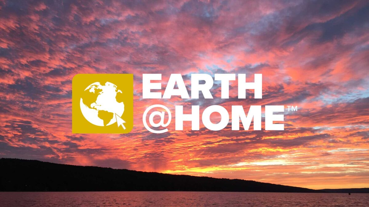 Earth@Home logo on a photograph of a sunset over a lake.