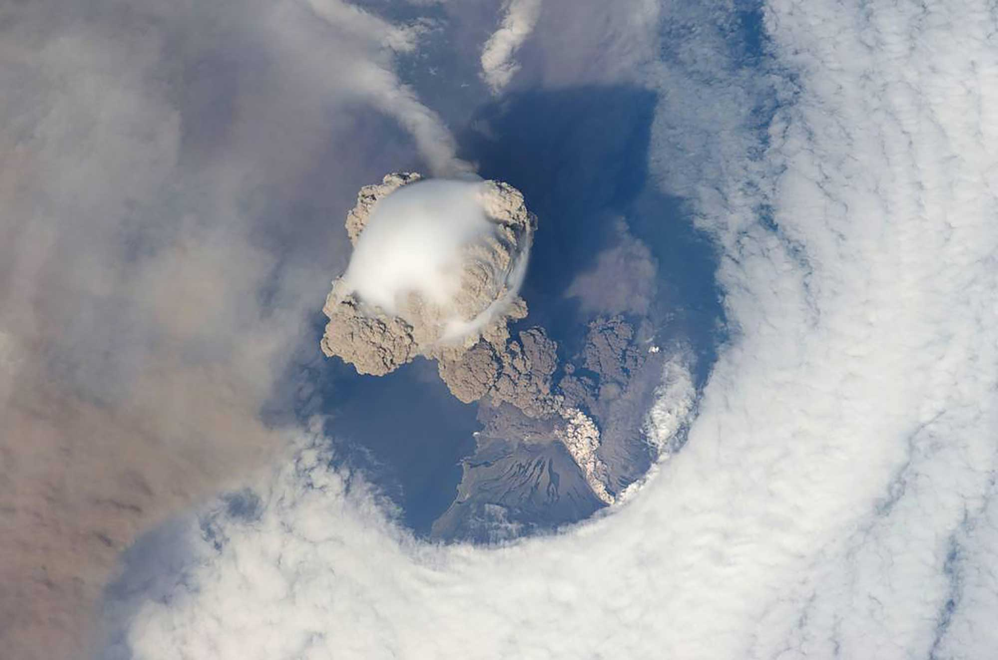 Photograph of an erupting volcano taken from space.